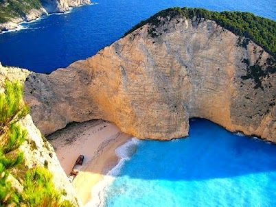 """Zakynthos Island Greece-Ralph Roberts originalmente compartilhou esta postagem:Navagio Beach, the Most Beautiful Beach of Greece ... Amusing Planet - """"Navagio Beach ... is an isolated sandy cove on Zakynthos island and one of the most famous and most photographed beaches in Greece. Navagio Beach is often referred to as the Shipwreck Beach ... because it is home to the wreck of a ship called Panagiotis that is believed to have been a smugglers ship. The presence of alleged smugglers ship gave N..: Bucket List, Beach Shipwreck, Favorite Places Spaces, Beautiful Beach, Photographed Beaches"""