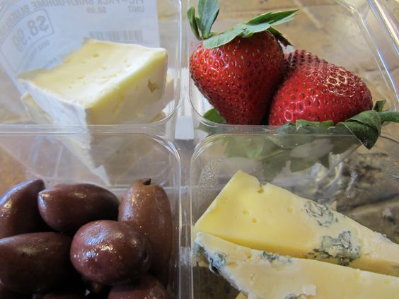 A Wild Oats Picnic Pack with a selection of local cheeses, fresh fruit and olives. Picnic packs come with a variety of selections, conveniently packaged for you to grab & go.