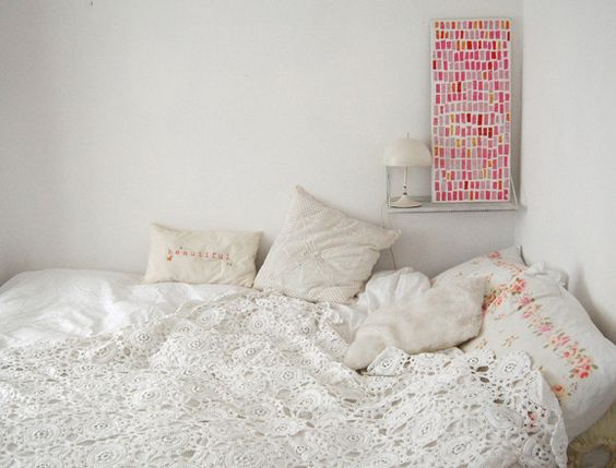Coverlet. There's a pattern similar to this in the book Comfort Knitting and Crochet: Afghans.