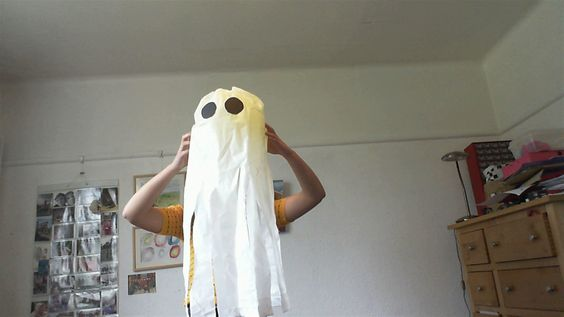 Fun ghosts for halloween. 1. Strip up a white bin bag using scissors. 2. Blow up a balloon and stick in up the bin bag using tape. 3. Cut out some black card circles and stick the on the balloon using prit stick glue.