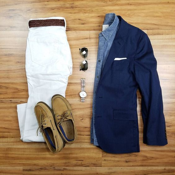 Styling the NAVY BLAZER in summer. White jeans a braided beltpaired with tan Sperry boat shoes exudes a maritime vibe. A light-weight chambrayfabric will keep you cool. Next you can throw on aviators and a striped nato strapped watch because its summer after all. Finallyfinish the simple in summer look off with a sliver of white pocket square for that subtle attention to detail that really makes all the difference. For more on the navy blazer and ways to style it in every season check out the article (Link in Bio)
