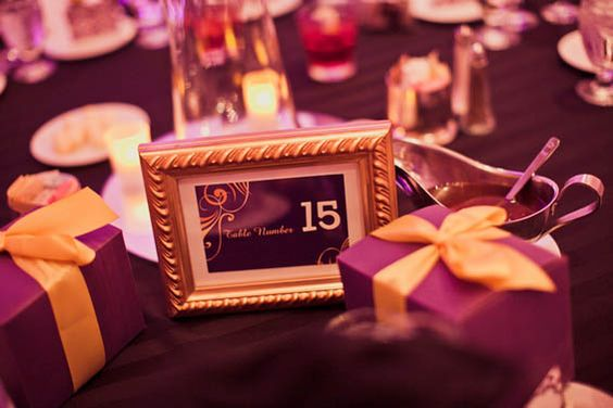 Purple and gold gift boxes for this LA Lakers-themed wedding