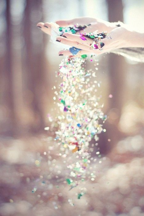 glitter *perhaps have a kid blowing them in the air while standing in an open field...?