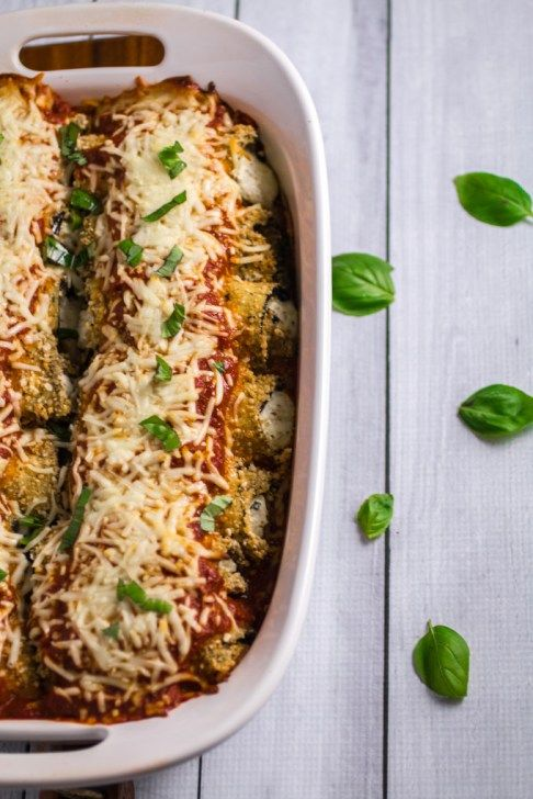 Savory oven-fried eggplant stuffed with an herby parmesan and ricotta cheese filling, smothered with marinara sauce and baked to perfection. This Easy Eggplant Rollatini is the perfect meal for when you just have to enjoy a hearty Italian dinner. A perfect match for your favorite bottle of vino, you won't believe how easy this dish is to make!