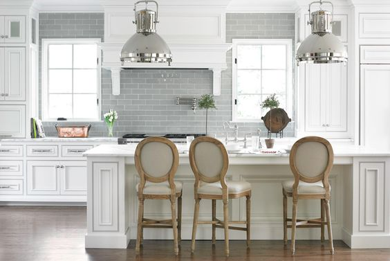A crisp gray-and-white palette, along with a mix of sleek surfaces, gives the kitchen a modern feel. - Traditional Home ® / Photo: Emily Followill / Design: Allison Hennessy:
