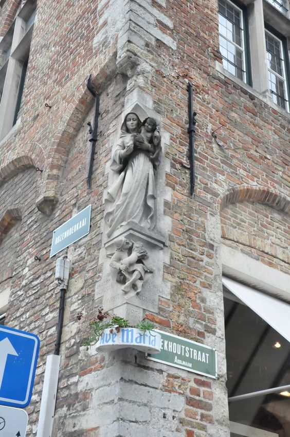 Ave Maria sculpture on corner of a building in Bruges Belgium: