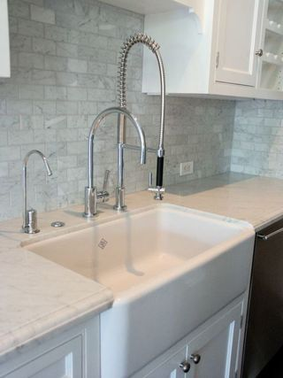 My dream kitchen would have an extra deep/wide cream farmhouse sink ...