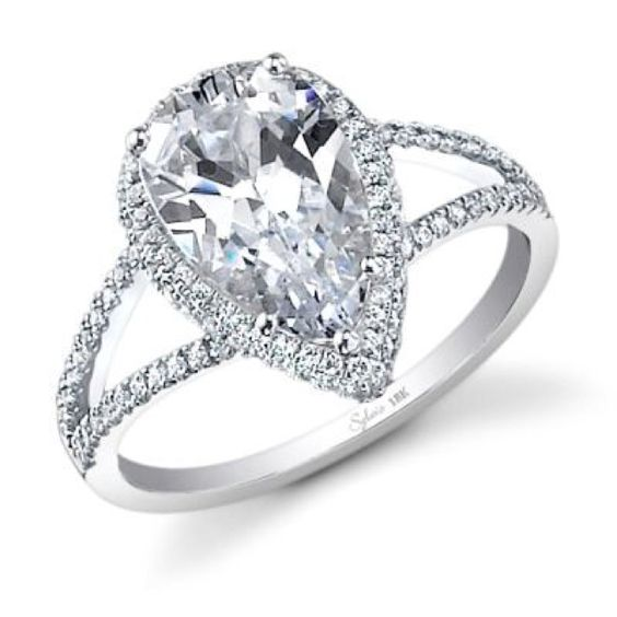 Pear shaped diamond engagement ring. I actually love how different this is