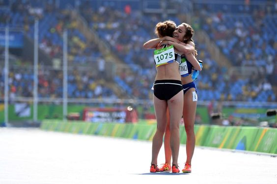 Abbey D'Agostino of the United States, right, hugs Nikki Hamblin of New Zealand after their women's 5000 preliminary heat in the Rio 2016 Summer Olympic Games.