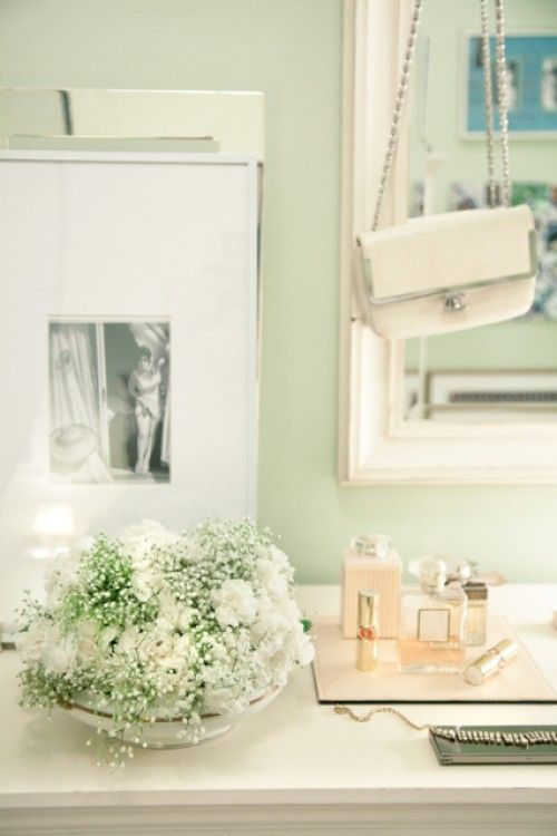 Katie Ermilio's gorgeous apartment by Rue. Love love love the pale green wall color