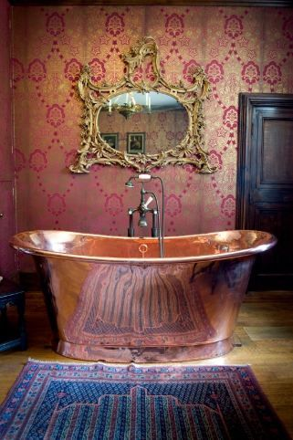 LOVE the copper tub... wall paper and mirror a bit much - but i can see it with painted wall as well...: