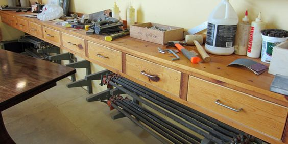 Store things (clamps or lumber) below the work surfaces.