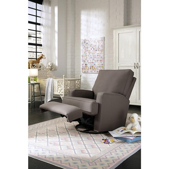 """After a long day, kick back and relax in the Kersey Upholstered Swivel Glider Recliner in the Shadow style. This cozy chair features sleek lines on its squared arms and back for a fashionable look that is great for any room of your home. With a simple pull on the inside handle you'll be reclining in no time, and the plush pillow back and soft, sturdy cushion provide the comfort you require while rocking baby to sleep. The hardwood frame, reinforced joints and steel mechanism mean this…"