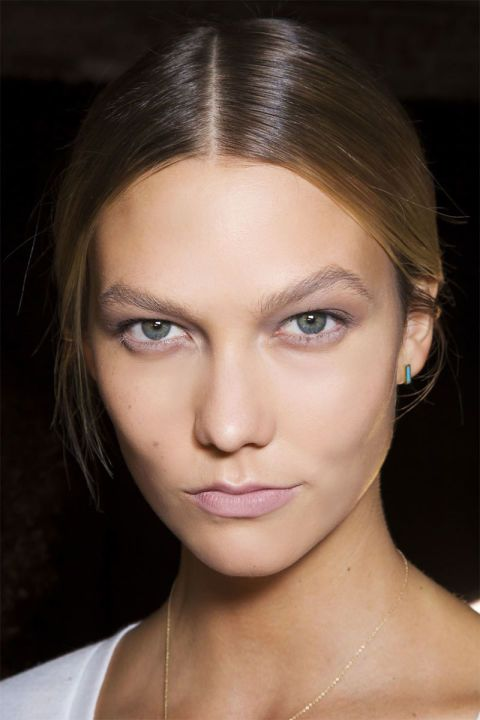 Brown shed its humdrum image and showed its versatility on the spring runways, showing up in shades of cool taupe at Donna Karan