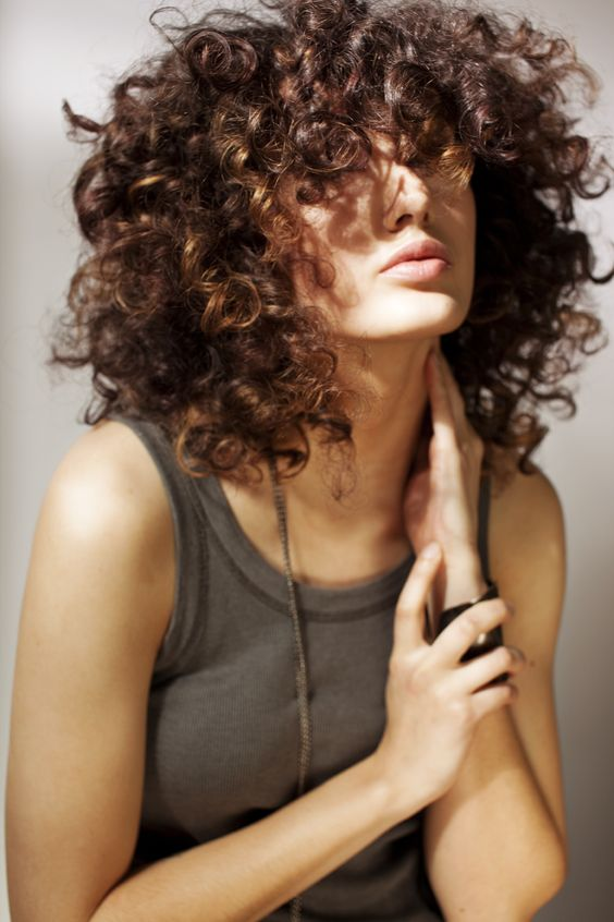 Oh please make curly/frizzy mops fashionable again.......