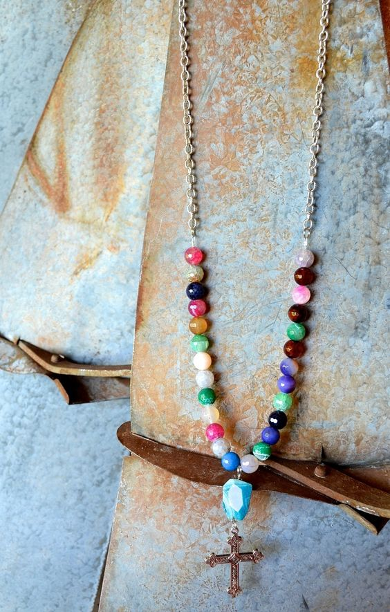 Our Bright Future necklace combines candy-colored agate gemstones with a rustic turquoise stone atop a silver cross charm. Wear with a neutral top to let it pop! [$36.95] Comment below with your PayPal email address to order, or visit:  bit.ly/1bZY2uf