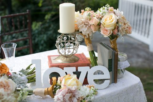 To Have & To Hold Weddings {vintage sweetheart table with candles and flowers}