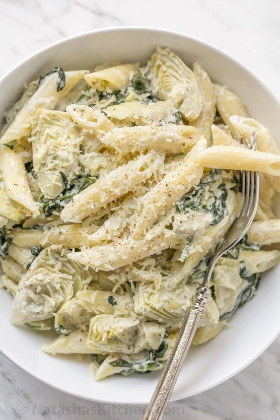 Spinach and Artichoke Pasta - Our favorite dip turned into a pasta! #sponsored by @reynoldswrap   natashaskitchen.com