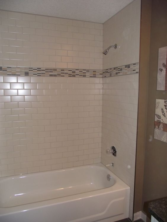 Main bathroom white subway tile tub surround offset for Main floor bathroom ideas