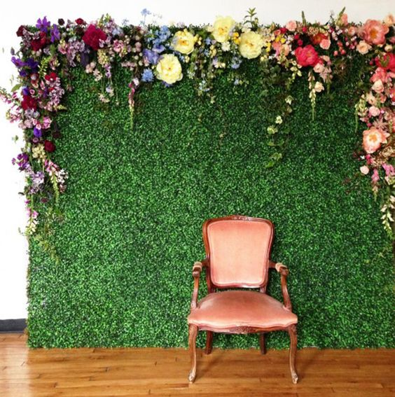 How cool is this? It's like an English Garden just popped up in your apartment! You could achieve something similar with astroturf or a giant photo of grass with actual flowers pinned to the top