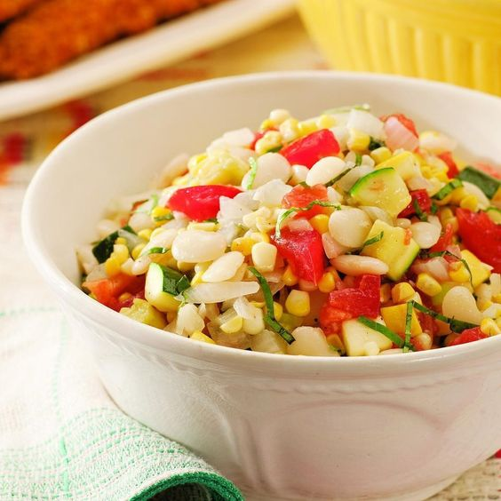 This summer salad is based on the Southern favorite, succotash, and is a fresh-tasting combination of butter beans, corn, summer squash and tomatoes. Butter beans, the same species as lima beans, are the bean of choice in the South. When they're in season you may be able to find them fresh--shell them yourself. Or use frozen butter beans, baby lima beans or even edamame.