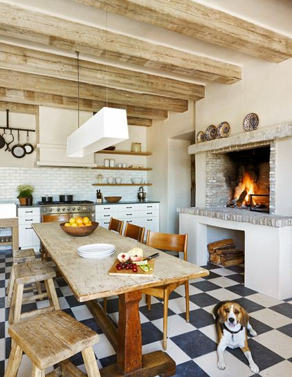 modern light fixtures and cabinets turn this rustic kitchen into unpredictable and eclectic