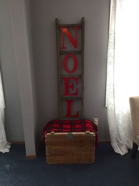 Old ladder and some wooden letters spray painted red and hung with twine!