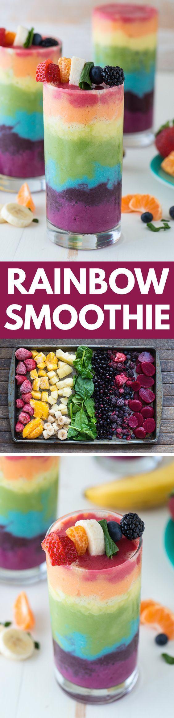 Hermosa 7 capas receta batido arco iris! Llena de toneladas de frutas y cubierto con una brocheta de fruta, que es lo último batido arco iris!: