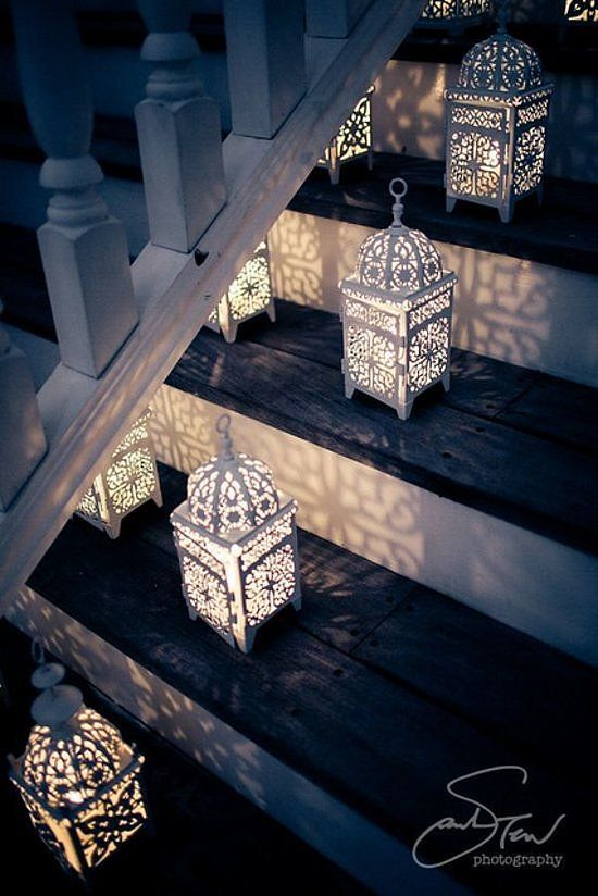Nothing's more memorable than Moroccan lanterns lined on the stairs. If you don't want to deal with the hassle of blowing out the candlelight, replace the real deal with battery-operated votives.