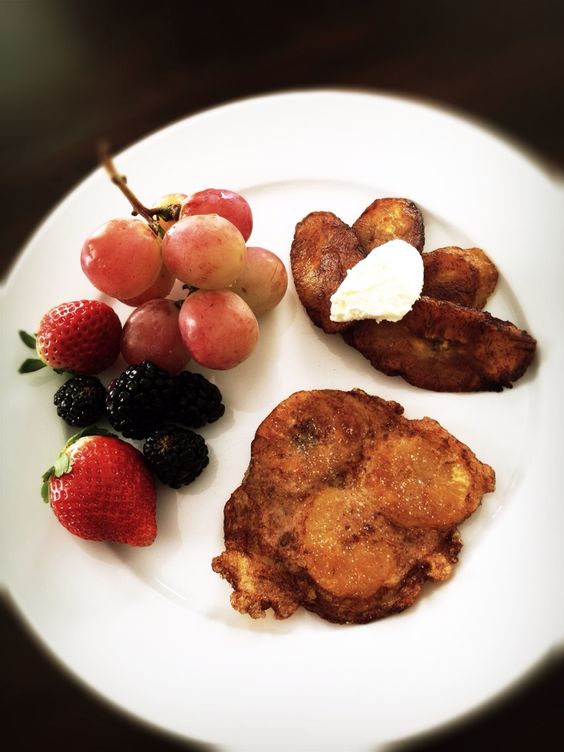 Afternoon snack with fresh fruits, fried plantains with mascarpone cream topping, and maruya with sprinkled sugar on top