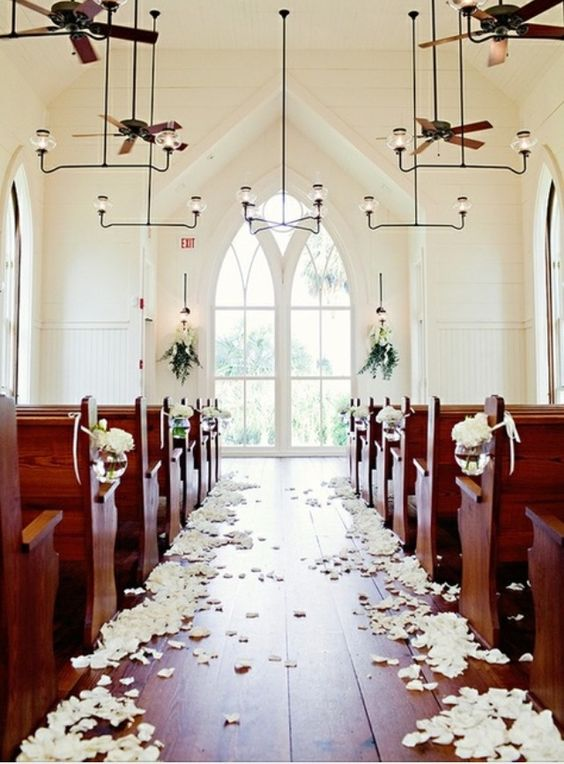One unique way to personalize your wedding at a church is to incorporate flower petals scattered on sides. #church #weddings #christian