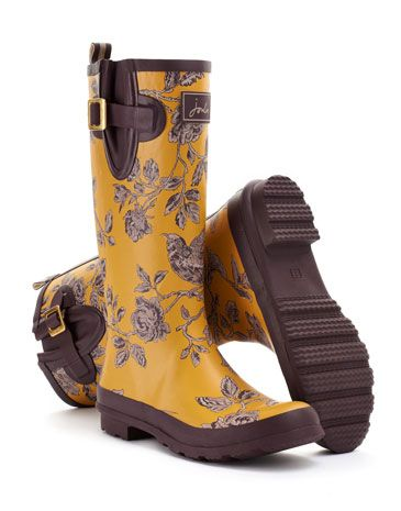 Joules Womens Printed Rain Boot, Caramel Floral.                     From striking stripes and detailed florals to scenes that sing of our country heritage. No matter where you are from farmyards to festivals, our new printed Rain Boots will make sure you stand out from the crowd.