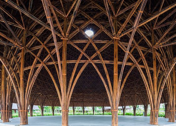 Vo Trong Nghia Architects has built a community centre of eight domed pavilions, each with intricate bamboo structures and thatched rooftops: