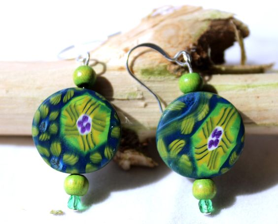 These hand crafted earrings remind me of lily pads in a shaded pond.  Made from polymer clay, I used my original polymer clay canes applied to a base of cobalt blue polymer clay.   If you are unfamiliar with polymer clay cane work, here is a brief ...
