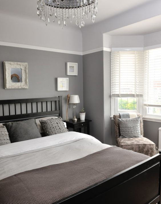 Different tones of grey give this bedroom a unique and ...