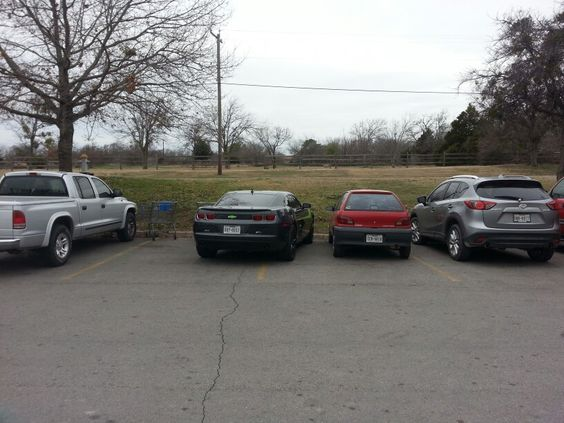 The asshole in the camaro didnt want anyone parkin next to him so I did.