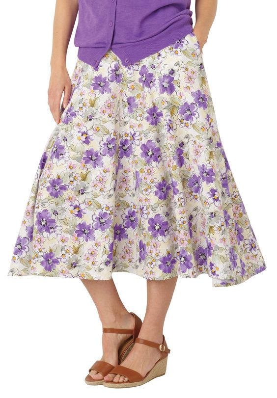 This cool, airy, plus size skirt is too pretty to pass up. The fabulous pattern is perfect for Spring and Summer.  skirt is non restrictive and flowy, full sweep 34&#34 inseam  natural fit sits at the waist full elastic waistband provides all around ease and roominess  handy side seam pockets, effortless draping  easy care, soft, washable woven 55% linen/45% rayon, imported     Women's summer skirt in sizes: S(12W), M(14W-16W), L(18W-20W), 1X(22W-24W), 2X(26W-28W), 3X(30W-32W...