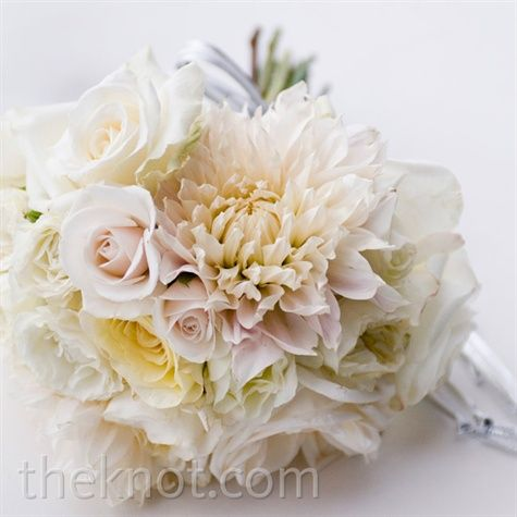 Krista carried a textured bouquet of white and cream spray roses and ruffled tulips.