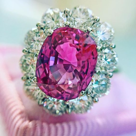 Jewels by Grace. Gorgeous 3.52ct cluster ring with a deeply-saturated, bright and lively purple-pink Ceylon sapphire - stunning on the finger! Set amidst a bold halo of icy-white diamonds. Platinum.