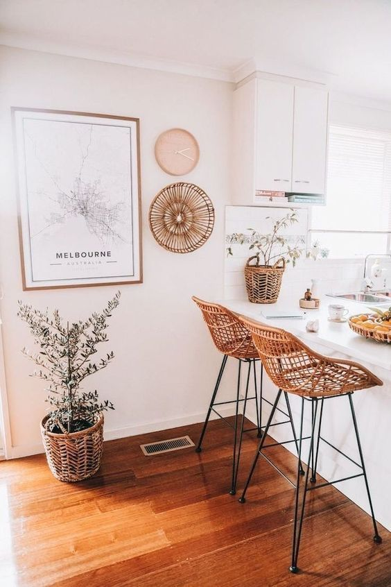 Bamboo chairs, dining room decor with large wall art.