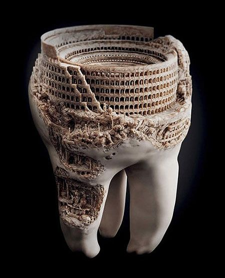 A sculpture of the Roman Colosseum, done in a real tooth.    Weird.