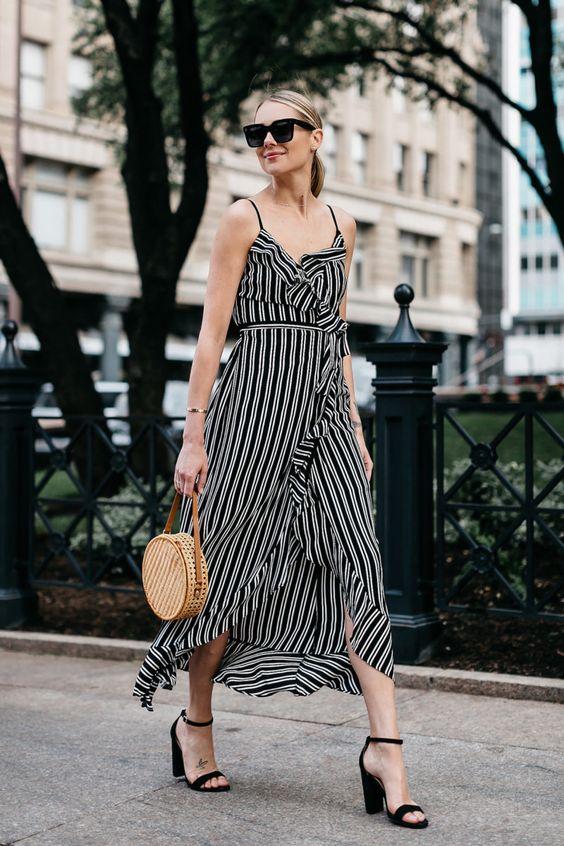 Blonde Woman Wearing AQUA Black White Stripe Maxi Dress Circle Straw Basket Handbag Black Ankle Strap Heeled Sandals Fashion Jackson Dallas Blogger Fashion Blogger Street Style