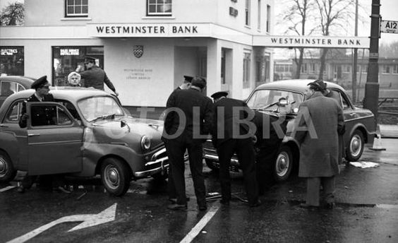 The bank in the background, at Lexden, Colchester, was one of the first drive through banks in the country. It still exists as NatWest. The 1960's
