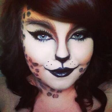 Halloween leopard print cat makeup.