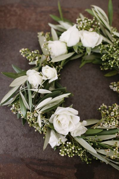 Floral crown of olive, eucalyptus seed pods and white ...