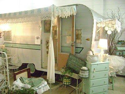 Vintage camper as antique shop display.