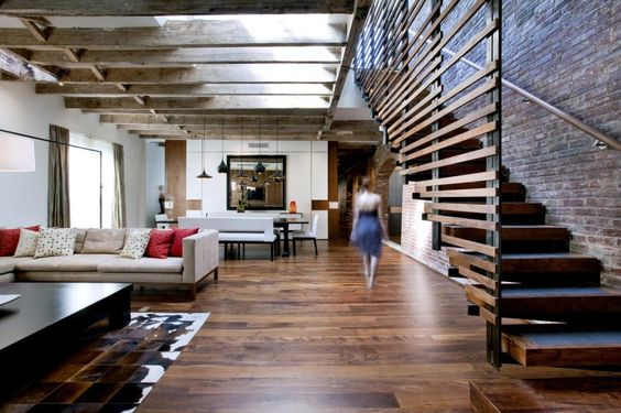 fabulous wood floors, exposed beams, and brick. love it!