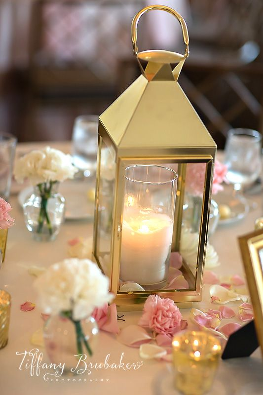 Gold lantern white and blush pink wedding decor by