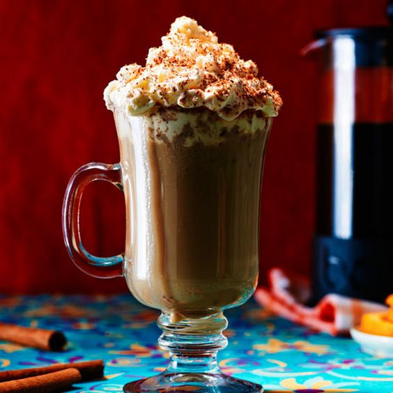 Orange Spiked Coffee Recipe Beverages with strong black coffee, irish cream liqueur, triple sec, sugar, heavy cream, cinnamon sticks