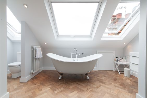 dormer loft conversion project in South West London. Open-plan master bedroom suite flooded with light.